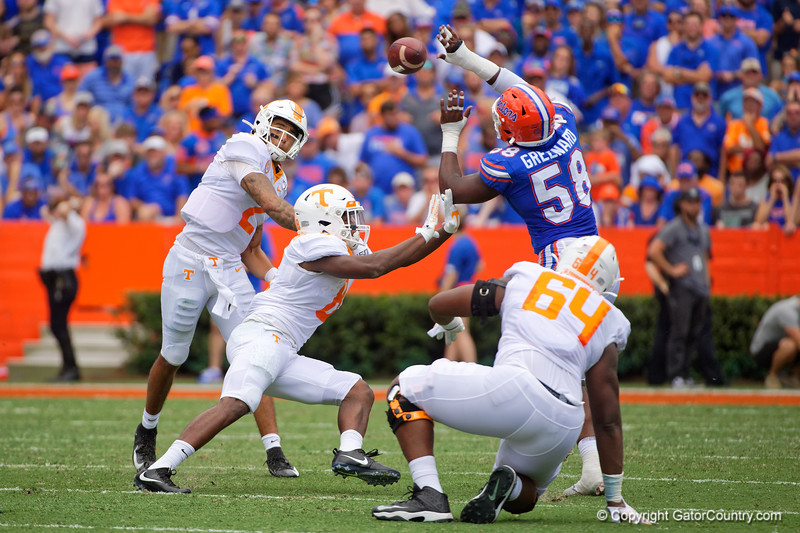 Florida Gators linebacker Jonathan Greenard (58) attempts to break up the pass from Tennessee Volunteers quarterback Jarrett Guarantano (2) as the Gators defeat SEC East rival the University of Tennessee Volunteers at Ben Hill Griffin Stadium in Gainesville, Florida on September 21st, 2019 (Photo by David Bowie/Gatorcountry)