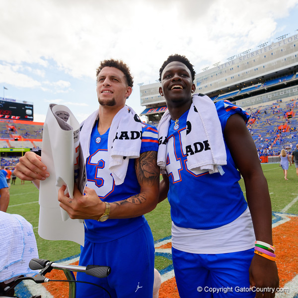 Florida Gators quarterback Feleipe Franks (13) and Florida Gators tight end Clifford Taylor IV (45) as the Gators celebrate defeating SEC East rival the University of Tennessee Volunteers at Ben Hill Griffin Stadium in Gainesville, Florida on September 21st, 2019 (Photo by David Bowie/Gatorcountry)