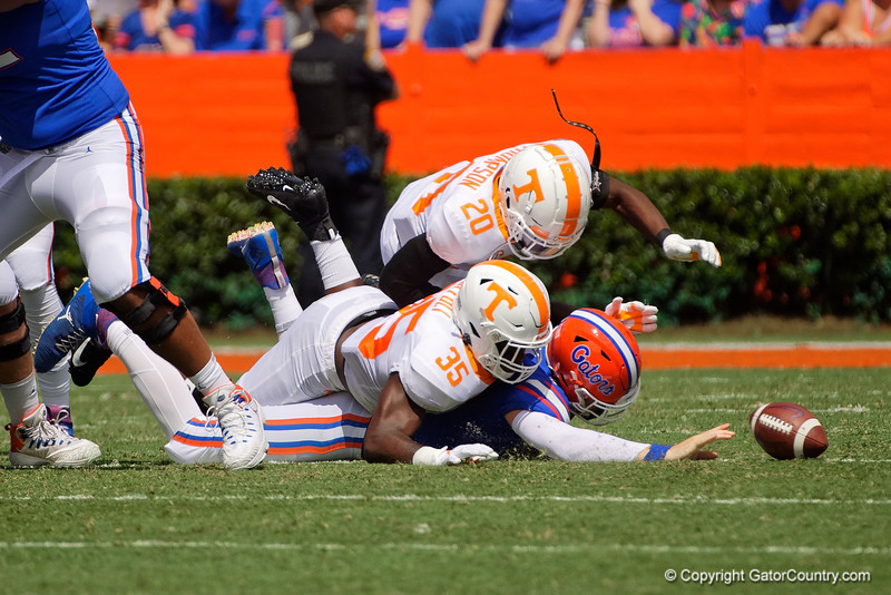 Florida Gators quarterback Kyle Trask (11) fumbles after a hit by Tennessee Volunteers linebacker Daniel Bituli (35) as the Gators defeat SEC East rival the University of Tennessee Volunteers at Ben Hill Griffin Stadium in Gainesville, Florida on September 21st, 2019 (Photo by David Bowie/Gatorcountry)