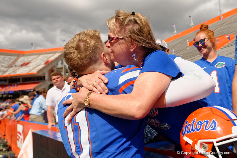 Florida Gators quarterback Kyle Trask (11) celebrates with his family as the Gators celebrate defeating SEC East rival the University of Tennessee Volunteers at Ben Hill Griffin Stadium in Gainesville, Florida on September 21st, 2019 (Photo by David Bowie/Gatorcountry)