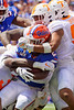 Florida Gators running back Lamical Perine (2) takes a forearm to the helmet as the Gators defeat SEC East rival the University of Tennessee Volunteers at Ben Hill Griffin Stadium in Gainesville, Florida on September 21st, 2019 (Photo by David Bowie/Gatorcountry)