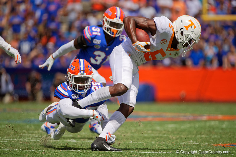 Florida Gators defensive back Chester Kimbrough (25) makes a diving tackle on Tennessee Volunteers wide receiver Josh Palmer (5) as the Gators defeat SEC East rival the University of Tennessee Volunteers at Ben Hill Griffin Stadium in Gainesville, Florida on September 21st, 2019 (Photo by David Bowie/Gatorcountry)