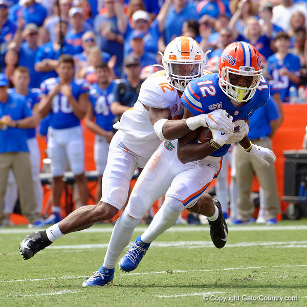 Florida Gators wide receiver Van Jefferson (12) makes a catch and fights to get tot he endzone with Tennessee Volunteers defensive back Shawn Shamburger (12) on his back, as the Gators defeat SEC East rival the University of Tennessee Volunteers at Ben Hill Griffin Stadium in Gainesville, Florida on September 21st, 2019 (Photo by David Bowie/Gatorcountry)