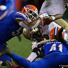 Florida Gators linebacker Jonathan Greenard (58) and Florida Gators linebacker James Houston IV (41) sack Florida State Seminoles quarterback James Blackman (1) as the Gators hosted and defeated the Florida State Seminoles 40-17 at Ben Hill Griffin Stadium in Gainesville, Florida on November 30th, 2019 (Photo by David Bowie/Gatorcountry)