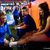 A Florida Gators cheerleader gets her ankle taped up as the Gators hosted and defeated the Florida State Seminoles 40-17 at Ben Hill Griffin Stadium in Gainesville, Florida on November 30th, 2019 (Photo by David Bowie/Gatorcountry)