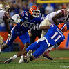 Florida Gators linebacker Mohamoud Diabate (11) sacking Florida State Seminoles quarterback James Blackman (1) as the Gators hosted and defeated the Florida State Seminoles 40-17 at Ben Hill Griffin Stadium in Gainesville, Florida on November 30th, 2019 (Photo by David Bowie/Gatorcountry)