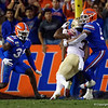 Florida Gators linebacker Ventrell Miller (51) tackles Florida State Seminoles running back Cam Akers (3) as the Gators hosted and defeated the Florida State Seminoles 40-17 at Ben Hill Griffin Stadium in Gainesville, Florida on November 30th, 2019 (Photo by David Bowie/Gatorcountry)