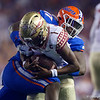 Florida Gators defensive lineman Zachary Carter (17) sacking Florida State Seminoles quarterback James Blackman (1) as the Gators hosted and defeated the Florida State Seminoles 40-17 at Ben Hill Griffin Stadium in Gainesville, Florida on November 30th, 2019 (Photo by David Bowie/Gatorcountry)