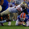 Florida Gators quarterback Kyle Trask (11) dives under Florida State Seminoles linebacker Emmett Rice (56) for a first down as the Gators hosted and defeated the Florida State Seminoles 40-17 at Ben Hill Griffin Stadium in Gainesville, Florida on November 30th, 2019 (Photo by David Bowie/Gatorcountry)