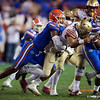 Florida Gators linebacker Jonathan Greenard (58) sacking Florida State Seminoles quarterback James Blackman (1) as the Gators hosted and defeated the Florida State Seminoles 40-17 at Ben Hill Griffin Stadium in Gainesville, Florida on November 30th, 2019 (Photo by David Bowie/Gatorcountry)