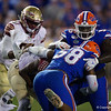 Florida Gators defensive lineman Tedarrell Slaton (56) and Florida Gators linebacker Jonathan Greenard (58) combine for a sack as the Gators hosted and defeated the Florida State Seminoles 40-17 at Ben Hill Griffin Stadium in Gainesville, Florida on November 30th, 2019 (Photo by David Bowie/Gatorcountry)