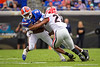 Florida Gators running back Lamical Perine (2) is tackled by Georgia Bulldogs linebacker Nate McBride (22) as the #6 Gators lose to the #6 Georgia Bulldogs 24-17 at TIAA Bank Field in Jacksonville, Florida on November 2nd, 2019 (Photo by David Bowie/Gatorcountry)