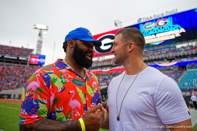 Tim Tebow and Brandon Spikes during pregame as the #6 prepare to take on the #6 Georgia Bulldogs at TIAA Bank Field in Jacksonville, Florida on November 2nd, 2019 (Photo by David Bowie/Gatorcountry)
