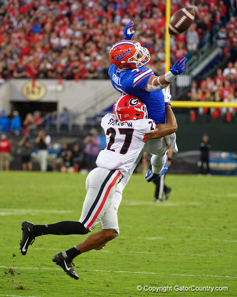 Florida Gators tight end Lucas Krull (7) leaps for a pass but is hit by Georgia Bulldogs defensive back Eric Stokes (27) as the #6 Gators lose to the #6 Georgia Bulldogs 24-17 at TIAA Bank Field in Jacksonville, Florida on November 2nd, 2019 (Photo by David Bowie/Gatorcountry)