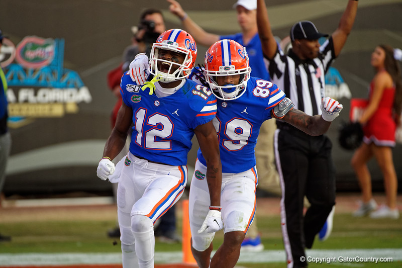 Florida Gators wide receiver Van Jefferson (12) and Florida Gators wide receiver Tyrie Cleveland (89) celebrate after a touchdown from Jefferson as the #6 Gators lose to the #6 Georgia Bulldogs 24-17 at TIAA Bank Field in Jacksonville, Florida on November 2nd, 2019 (Photo by David Bowie/Gatorcountry)