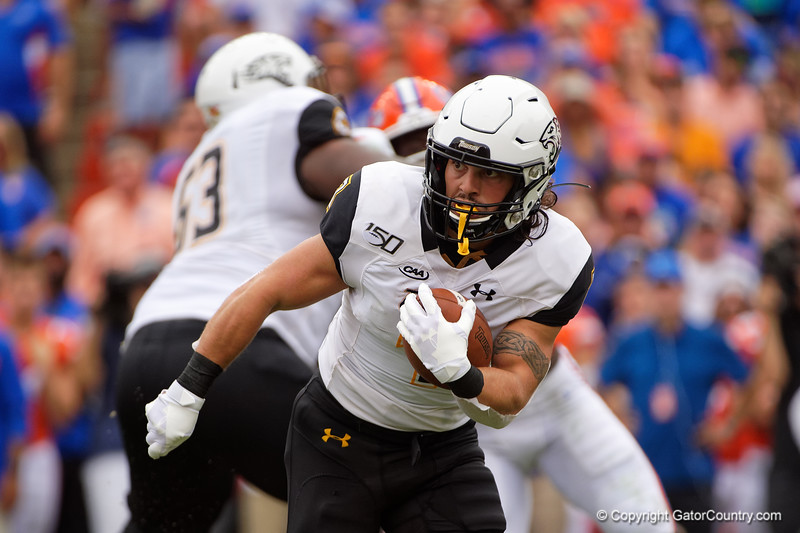 Towson Tigers running back Adrian Feliz-Platt (7) rushing as the Gators defeat the Towson Tigers 38-0 at Ben Hill Griffin Stadium in Gainesville, Florida on September 28th, 2019 (Photo by David Bowie/Gatorcountry)