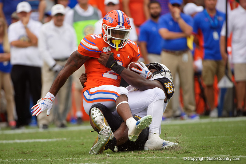 Florida Gators running back Lamical Perine (2) is tackled by Towson Tigers defensive lineman Bryce Carter (53) as the Gators defeat the Towson Tigers 38-0 at Ben Hill Griffin Stadium in Gainesville, Florida on September 28th, 2019 (Photo by David Bowie/Gatorcountry)