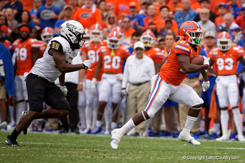 Florida Gators running back Dameon Pierce (27) rushing as the Gators defeat the Towson Tigers 38-0 at Ben Hill Griffin Stadium in Gainesville, Florida on September 28th, 2019 (Photo by David Bowie/Gatorcountry)