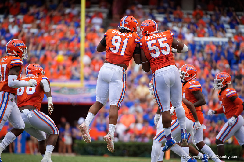 Florida Gators defensive lineman Marlon Dunlap Jr. (91) and Florida Gators defensive lineman Kyree Campbell (55) as the Gators defeat the Towson Tigers 38-0 at Ben Hill Griffin Stadium in Gainesville, Florida on September 28th, 2019 (Photo by David Bowie/Gatorcountry)
