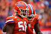 Florida Gators linebacker Jonathan Greenard (58) helps Florida Gators linebacker Jeremiah Moon (7) to the sideline as the Gators defeat the Towson Tigers 38-0 at Ben Hill Griffin Stadium in Gainesville, Florida on September 28th, 2019 (Photo by David Bowie/Gatorcountry)