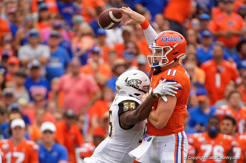 Florida Gators quarterback Kyle Trask (11) gets hit by Towson Tigers linebacker Christian Dixon (55) as the Gators defeat the Towson Tigers 38-0 at Ben Hill Griffin Stadium in Gainesville, Florida on September 28th, 2019 (Photo by David Bowie/Gatorcountry)