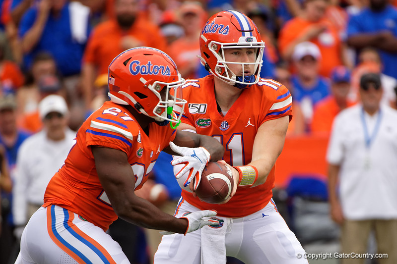 Florida Gators quarterback Kyle Trask (11) hands the ball off to  Florida Gators running back Dameon Pierce (27) as the Gators defeat the Towson Tigers 38-0 at Ben Hill Griffin Stadium in Gainesville, Florida on September 28th, 2019 (Photo by David Bowie/Gatorcountry)