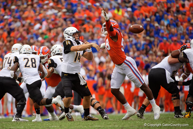 Florida Gators linebacker Jonathan Greenard (58) attempts to knock down a pass by Towson Tigers quarterback Tom Flacco (14)s the Gators defeat the Towson Tigers 38-0 at Ben Hill Griffin Stadium in Gainesville, Florida on September 28th, 2019 (Photo by David Bowie/Gatorcountry)