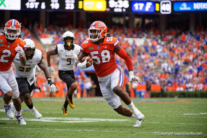 Florida Gators linebacker Jonathan Greenard (58) intercepts a pass as the Gators defeat the Towson Tigers 38-0 at Ben Hill Griffin Stadium in Gainesville, Florida on September 28th, 2019 (Photo by David Bowie/Gatorcountry)