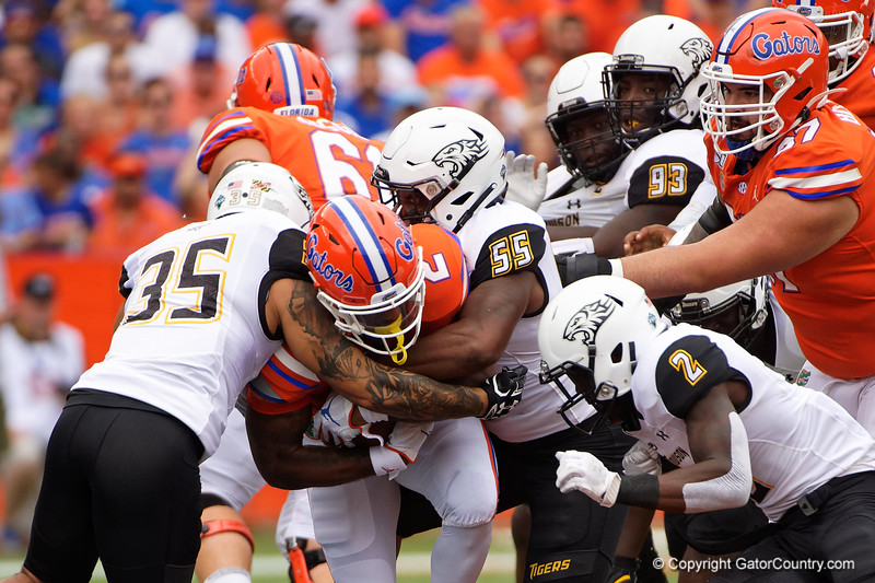 Florida Gators running back Lamical Perine (2) is tackled by Towson Tigers linebacker Christian Dixon (55) as the Gators defeat the Towson Tigers 38-0 at Ben Hill Griffin Stadium in Gainesville, Florida on September 28th, 2019 (Photo by David Bowie/Gatorcountry)