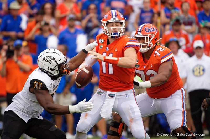 Florida Gators quarterback Kyle Trask (11) is pressured by Towson Tigers linebacker Malik Tyne (31) as the Gators defeat the Towson Tigers 38-0 at Ben Hill Griffin Stadium in Gainesville, Florida on September 28th, 2019 (Photo by David Bowie/Gatorcountry)