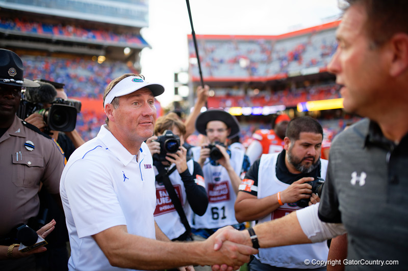 Florida Gators head coach Dan Mullen shakes hands with Towson Tigers head coach Rob Ambrose as the Gators defeat the Towson Tigers 38-0 at Ben Hill Griffin Stadium in Gainesville, Florida on September 28th, 2019 (Photo by David Bowie/Gatorcountry)