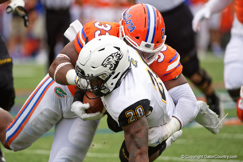 Florida Gators linebacker David Reese II (33) tackling Towson Tigers running back Yeedee Thaenrat (28) as the Gators defeat the Towson Tigers 38-0 at Ben Hill Griffin Stadium in Gainesville, Florida on September 28th, 2019 (Photo by David Bowie/Gatorcountry)