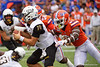 Florida Gators linebacker Jonathan Greenard (58) and Florida Gators defensive back Trey Dean III (21) tackle Towson Tigers quarterback Tom Flacco (14) as the Gators defeat the Towson Tigers 38-0 at Ben Hill Griffin Stadium in Gainesville, Florida on September 28th, 2019 (Photo by David Bowie/Gatorcountry)