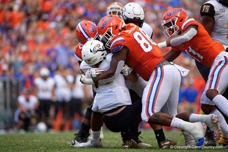 Towson Tigers quarterback Tom Flacco (14) is sacked by Florida Gators defensive lineman Marlon Dunlap Jr. (91) and Florida Gators defensive lineman Adam Shuler (88) as the Gators defeat the Towson Tigers 38-0 at Ben Hill Griffin Stadium in Gainesville, Florida on September 28th, 2019 (Photo by David Bowie/Gatorcountry)