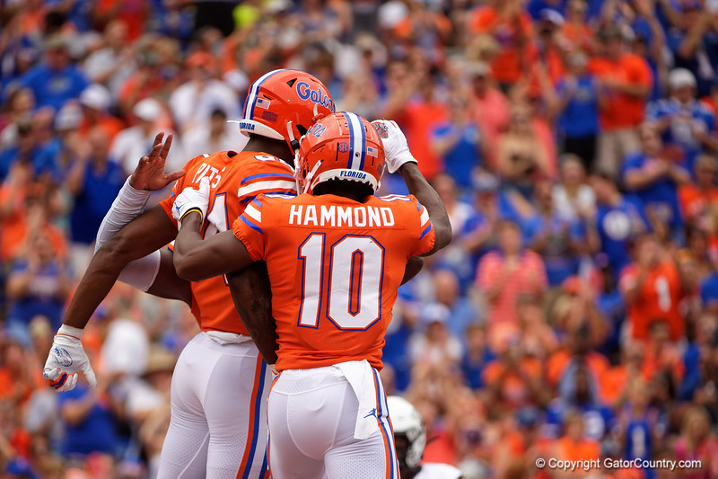 Florida Gators tight end Kyle Pitts (84) and Florida Gators wide receiver Josh Hammond (10) celebrate after a touchdown by Pitts as the Gators defeat the Towson Tigers 38-0 at Ben Hill Griffin Stadium in Gainesville, Florida on September 28th, 2019 (Photo by David Bowie/Gatorcountry)