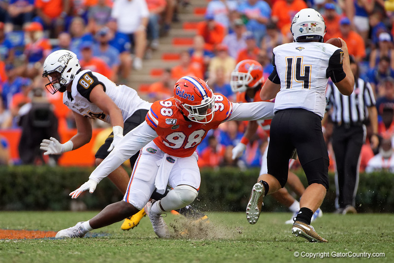 Florida Gators defensive lineman Luke Ancrum (98) attempts to sack Towson Tigers quarterback Tom Flacco (14) as the Gators defeat the Towson Tigers 38-0 at Ben Hill Griffin Stadium in Gainesville, Florida on September 28th, 2019 (Photo by David Bowie/Gatorcountry)