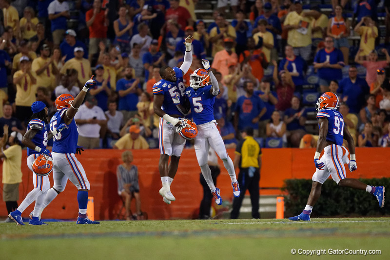 Florida Gators defensive back Kaiir Elam (5) celebrates with Florida Gators linebacker Jonathan Greenard (58) after Elam's first interception as the Gators faced the Tennessee-Martin Skyhawks at Ben Hill Griffin Stadium in Gainesville, Florida on September 8th, 2019 (Photo by David Bowie/Gatorcountry)