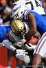 Vanderbilt Commodores running back Ke'Shawn Vaughn (5) is tackled as the Florida Gators defeat the Vanderbilt Commodores 56-0 at Ben Hill Griffin Stadium in Gainesville, Florida on November 9th, 2019 (Photo by David Bowie/Gatorcountry)