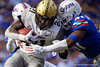 Vanderbilt Commodores running back Keyon Brooks (21) is tackled by Florida Gators linebacker James Houston IV (41) as the Gators faced and defeat the Vanderbilt Commodores 56-0 at Ben Hill Griffin Stadium in Gainesville, Florida on November 9th, 2019 (Photo by David Bowie/Gatorcountry)