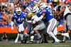 Florida Gators linebacker Mohamoud Diabate (11),Florida Gators defensive lineman Kyree Campbell (55) and Florida Gators linebacker Lacedrick Brunson (34) combine for a tackle as the Gators faced and defeat the Vanderbilt Commodores 56-0 at Ben Hill Griffin Stadium in Gainesville, Florida on November 9th, 2019 (Photo by David Bowie/Gatorcountry)