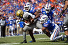 Florida Gators linebacker Jonathan Greenard (58) tackles Vanderbilt Commodores running back Keyon Brooks (21) as the Gators faced and defeat the Vanderbilt Commodores 56-0 at Ben Hill Griffin Stadium in Gainesville, Florida on November 9th, 2019 (Photo by David Bowie/Gatorcountry)