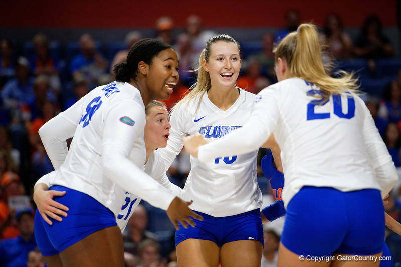 Florida Gators middle blocker Lauren Dooley (99),Florida Gators setter Marlie Monserez (21),Florida Gators Holly Carlton (40) and Florida Gators outside hitter Thayer Hall (20) celebrating as the Gators faced the #1 Stanford Cardinals at the Stephen C. O'Connell Center in Gainesville, Florida on September 4th, 2019 (Photo by David Bowie/Gatorcountry)