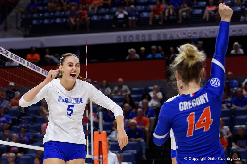 Florida Gators middle blocker Rachael Kramer (5) and Florida Gators libero Allie Gregory (14) celebrating as the Gators faced the #1 Stanford Cardinals at the Stephen C. O'Connell Center in Gainesville, Florida on September 4th, 2019 (Photo by David Bowie/Gatorcountry)