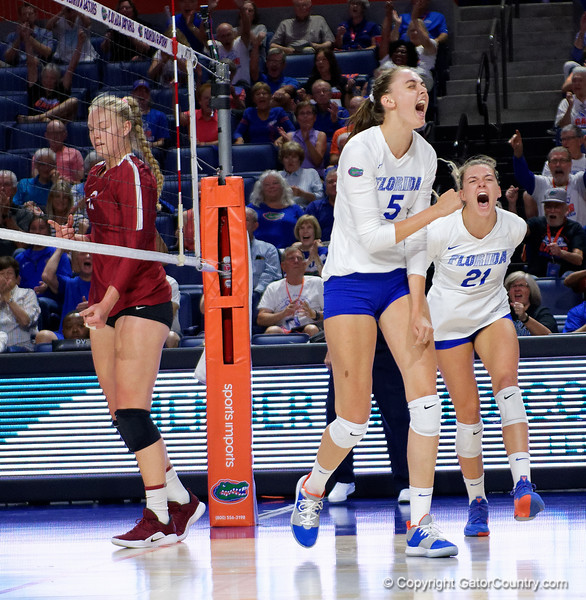 Florida Gators middle blocker Rachael Kramer (5) and Florida Gators setter Marlie Monserez (21) celebrate as the Gators faced the #1 Stanford Cardinals at the Stephen C. O'Connell Center in Gainesville, Florida on September 4th, 2019 (Photo by David Bowie/Gatorcountry)