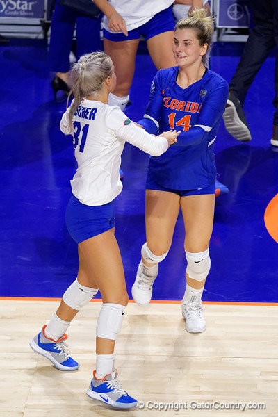 Florida Gators libero Allie Gregory (14) and Florida Gators Riley Fischer (31) as the Gators faced the #1 Stanford Cardinals at the Stephen C. O'Connell Center in Gainesville, Florida on September 4th, 2019 (Photo by David Bowie/Gatorcountry)