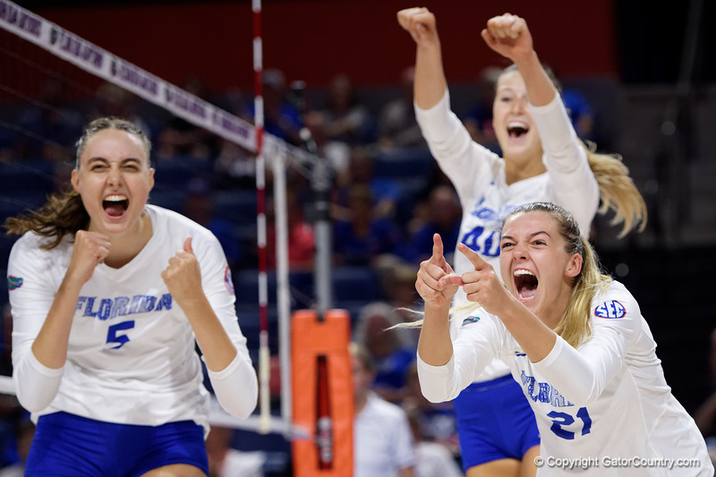 Florida Gators setter Marlie Monserez (21),Florida Gators middle blocker Rachael Kramer (5) and Florida Gators Holly Carlton (40) celebrating as the Gators faced the #1 Stanford Cardinals at the Stephen C. O'Connell Center in Gainesville, Florida on September 4th, 2019 (Photo by David Bowie/Gatorcountry)