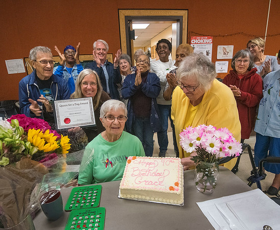 James Neiss/staff photographer <br /> Niagara Falls, NY - John Duke Senior Center volunteers surprised Grace Monaco with a cake for her 90th birthday, and named her Queen for a Day for being a volunteer for over 22 years there.