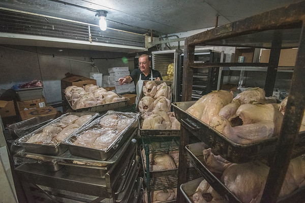 James Neiss/staff photographer <br /> Niagara Falls, NY - More than 170 families don't have to cook this Thanksgiving, letting the chefs at the Como Restaurant do all the work. Co-owner Louis Antonacci said all these turkeys will go into their massive oven at once and will be finished to perfection in just a few hours.