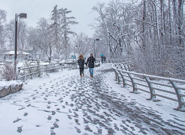 James Neiss/staff photographer <br /> Niagara Falls, NY - Tourists stroll the Goat Island pathways taking in the winter views. Mother nature nicely decorated the landscape around Niagara Falls State Park on Monday.