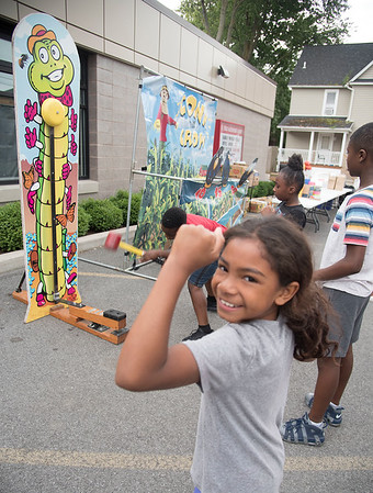 James Neiss/Staff Photographer<br /> Lockport, NY - Saige McKinney, 9, shows off her muscles after ringing the bell at the Lockport Salvation Army Carnival.